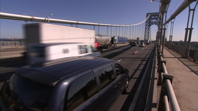 a tow truck slowly pushes a vehicle on a congested freeway. - tow truck stock videos and b-roll footage