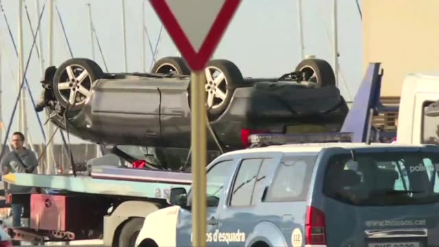 tow truck takes away the wrecked car from the scene of an attack in cambrils spain after drivers ploughed into pedestrians in two separate attacks in... - cambrils stock videos & royalty-free footage