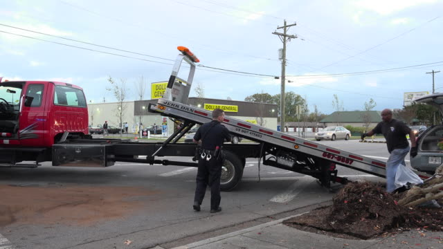 tow truck working on afternoon rush hour head on collision accident - tow truck stock videos and b-roll footage