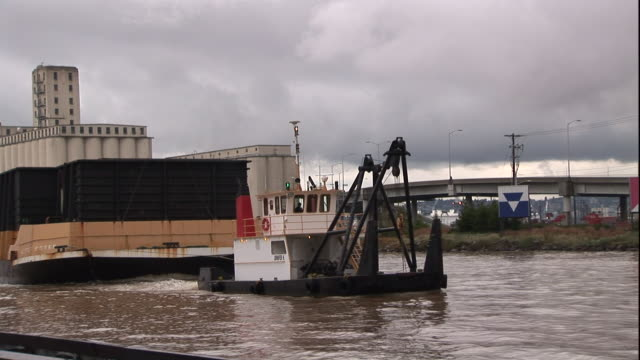 a tow vessel pulls a barge into puget sound. - puget sound stock videos & royalty-free footage