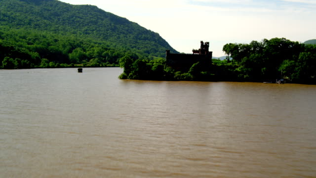 WIDE AERIAL POV toward and over ruins of Bannermans Castle on Pollepel Island in Hudson River