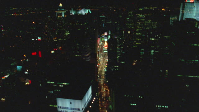 AERIAL toward + over Times Square at night / NYC