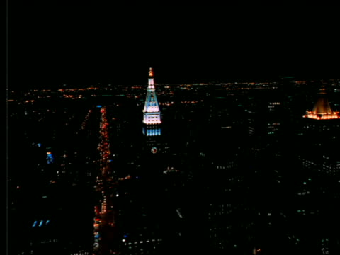 aerial toward + past met life building at night / nyc - cinematography stock videos & royalty-free footage