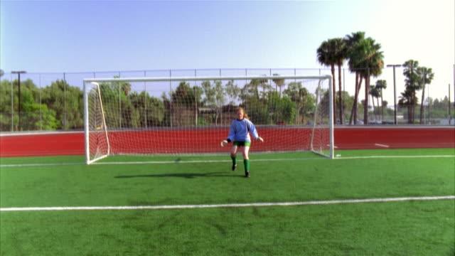 slo mo, pov toward  soccer goalie in front of goalpost, biola university, la mirada, california, usa  - fan palm tree stock videos & royalty-free footage