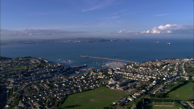 towards torbay over brixham  - aerial view - england, torbay, brixham, united kingdom - devon stock videos & royalty-free footage