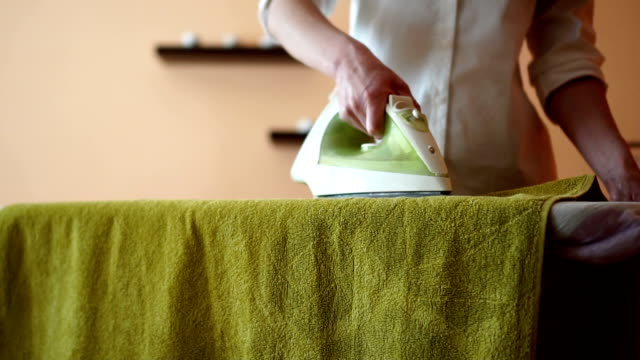 towel ironing - housework stock videos & royalty-free footage