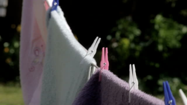 towels blowing in the breeze - washing line stock videos & royalty-free footage