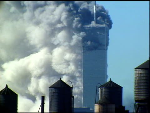 tower 1 minutes after tower 2 collapsed. smoke. sound: radio news interview w/ witness. shot from manhattan rooftop. - 2001 stock videos & royalty-free footage