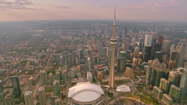 aerial cn tower and rogers centre in downtown toronto, ontario at sunset - toronto stock videos & royalty-free footage