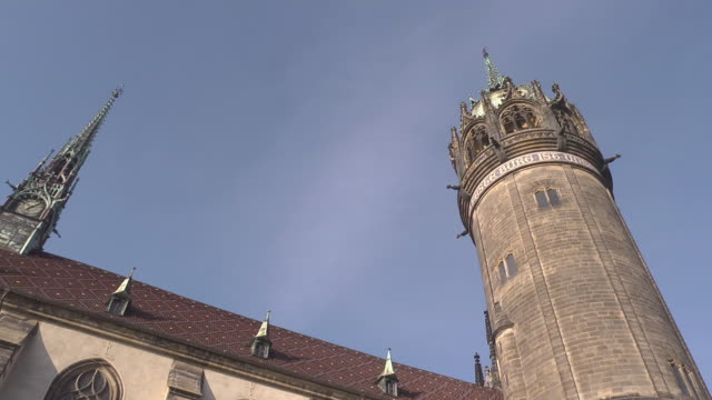 tower and roof of the castle church / schlosskirche - christianity stock videos & royalty-free footage