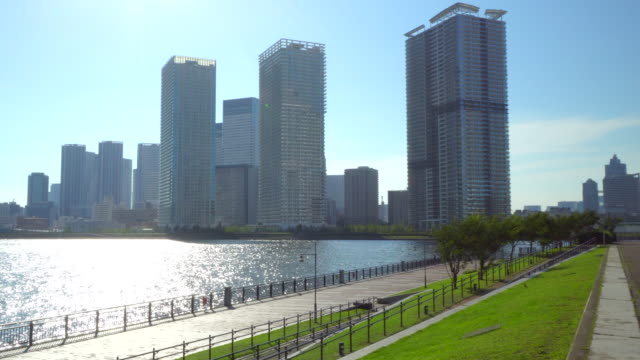 tower apartment from the promenade along the river - plusphoto stock videos & royalty-free footage