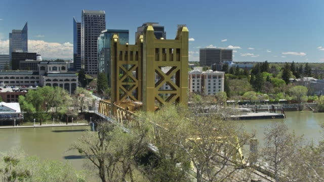tower bridge and downtown sacramento from west sacramento - aerial - tower bridge stock videos & royalty-free footage