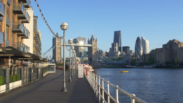 tower bridge and the city early morning.4k. - promenade stock videos & royalty-free footage