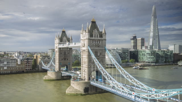tower bridge and the river thames in london. - bascule bridge stock videos & royalty-free footage