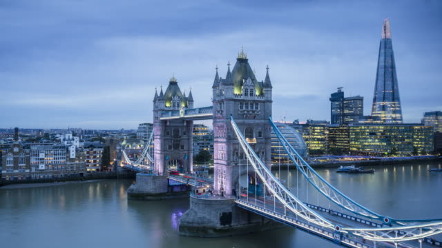 tower bridge and the river thames in london. - bascule bridge stock videos and b-roll footage