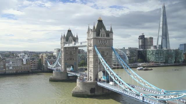 tower bridge and the river thames in london. - shard london bridge stock videos & royalty-free footage