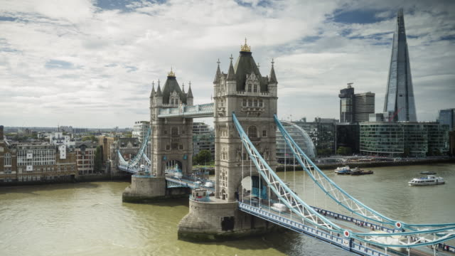 tower bridge and the river thames in london. - tower bridge stock videos & royalty-free footage