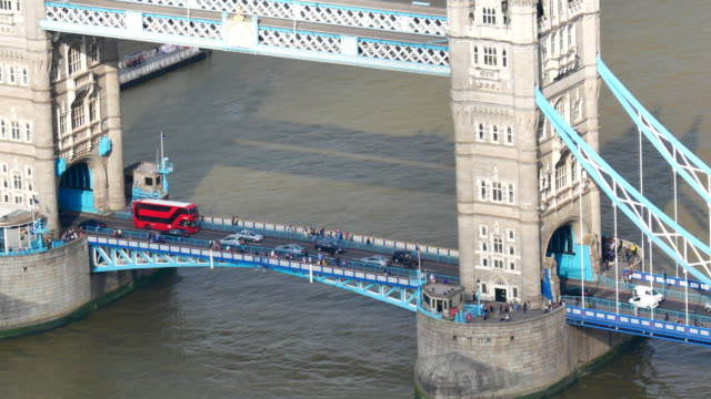 4k tower bridge and traffic in london, england - bus stock videos & royalty-free footage