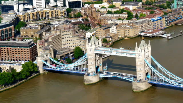 tower bridge and traffic in london, england - london bridge england stock videos and b-roll footage