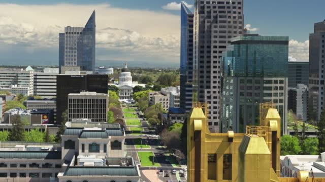 tower bridge, california state capitol and downtown sacramento - ascending aerial - sacramento stock videos & royalty-free footage
