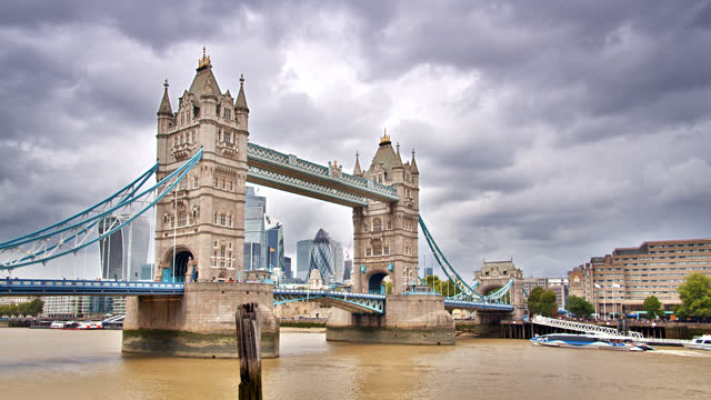 tower bridge. financial district in background - central london stock videos & royalty-free footage
