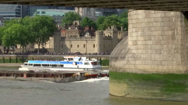 tower bridge general views; england: london: tower bridge: ext wide shots of bridge and river thames / boats along river / tower of london / details... - tower of london stock videos & royalty-free footage