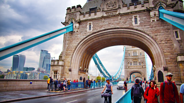 tower bridge in london, uk. tourists walk by. close up view of national landmark. - male likeness stock videos & royalty-free footage