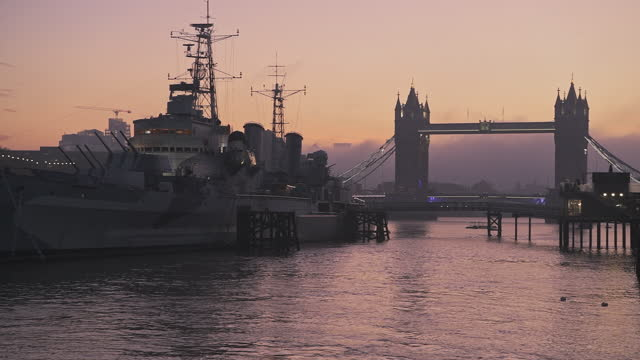 tower bridge in london with beautiful colourful sunrise, dramatic clouds and orange sky, showing iconic famous skyline on day one of coronavirus covid-19 lockdown in england, uk - british military stock videos & royalty-free footage