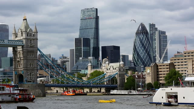tower bridge in london with business district - tower bridge stock videos & royalty-free footage