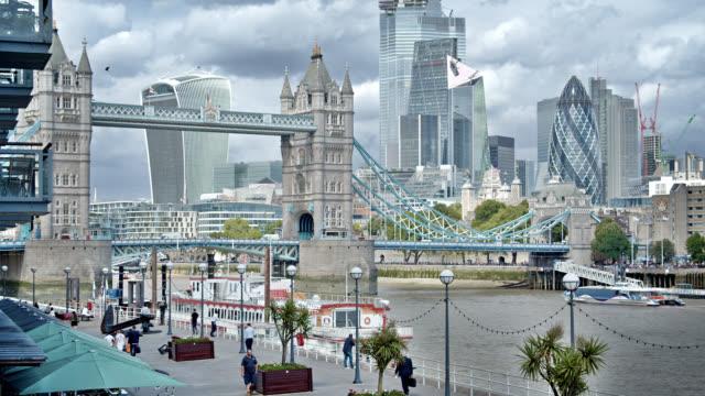 tower bridge. london business district. pedestrian bay. - international landmark stock videos & royalty-free footage