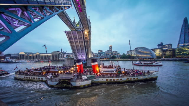 tower bridge london opening for passing boat. - tower of london stock videos and b-roll footage
