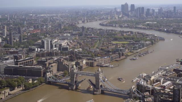 Tower Bridge opening on the River Thames,  London, UK.