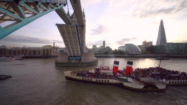 tower bridge opens more often in the summer and autumn months. a time table and list of vessels is available online. - local landmark stock videos and b-roll footage