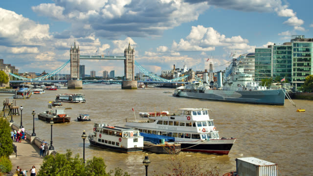 tower bridge. thames river. people walk. tree. hms belfast - docks stock videos & royalty-free footage