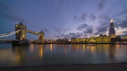 Tower bridge with London skyline, dusk to night time lapse