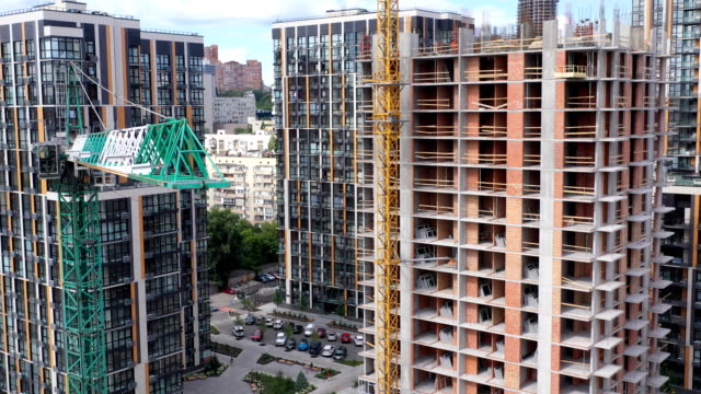 tower crane at residential building construction - construction site stock videos & royalty-free footage