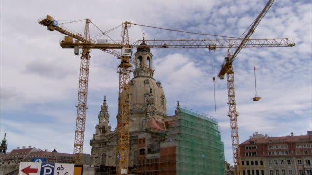 tower cranes work on the facade of the dresden frauenkirche in germany. available in hd. - dresden frauenkirche stock videos & royalty-free footage