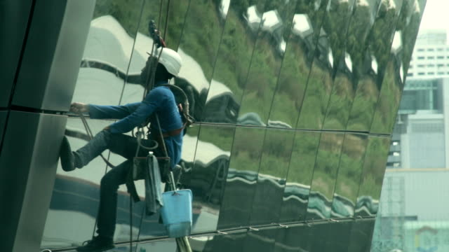 tower glass cleaning - window washer stock videos & royalty-free footage