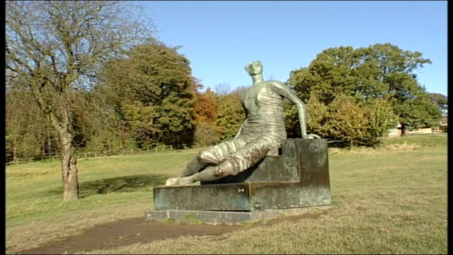 """tower hamlets want return of henry moore sculpture to sell; cutaway yorkshire: yorkshire sculpture park: """"draped seated woman"""" sculpture - henry moore stock videos & royalty-free footage"""