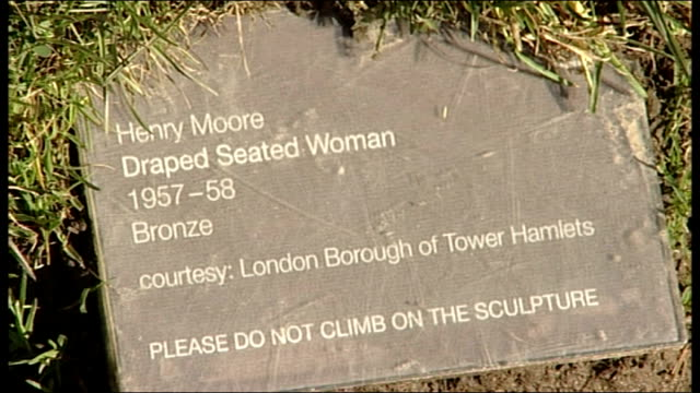 """tower hamlets want return of henry moore sculpture to sell; england: yorkshire: yorkshire sculpture park: ext """"draped seated woman"""" sculpture by... - henry moore stock videos & royalty-free footage"""