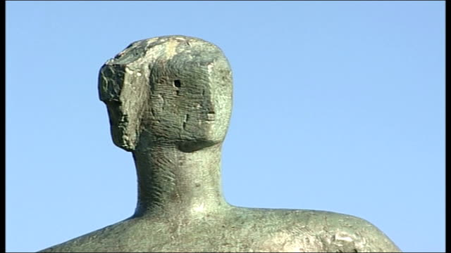 """tower hamlets want return of henry moore sculpture to sell; yorkshire: yorkshire sculpture park: various of """"draped seated woman"""" sculpture - henry moore stock videos & royalty-free footage"""