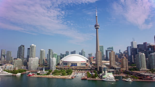 aerial cn tower in downtown toronto, ontario in sunshine - toronto stock videos & royalty-free footage