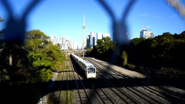 cn tower next to the railroad tracks (toronto) - safety rail stock videos & royalty-free footage
