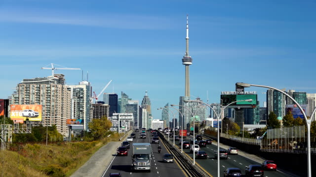 cn tower next to the railroad tracks (toronto) - cn tower stock videos & royalty-free footage