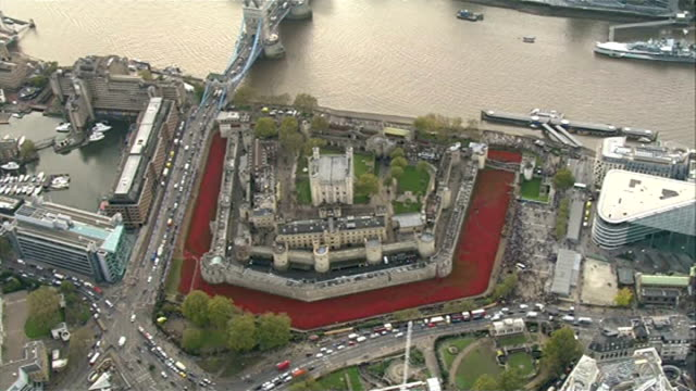 tower of london poppy installation creators receive mbe awards lib london tower of london tower of london with 'blood swept lands and seas of red'... - moat stock videos & royalty-free footage