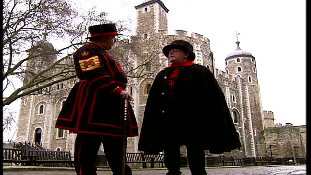 stockvideo's en b-roll-footage met tower of london unveils first female beefeater tx low angle shot of male beefeaters outside tower of london then along - yeomen warder