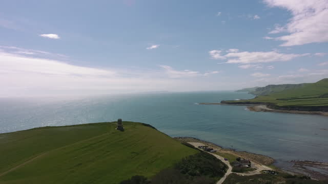tower overlooks dramatic headland - rock face stock videos & royalty-free footage