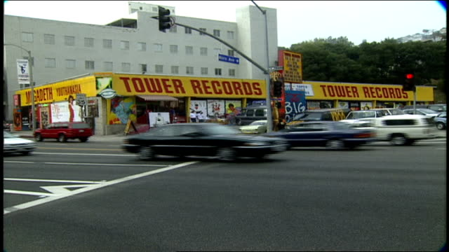 tower records sunset blvd sign traffic in los angeles california - anno 1994 video stock e b–roll