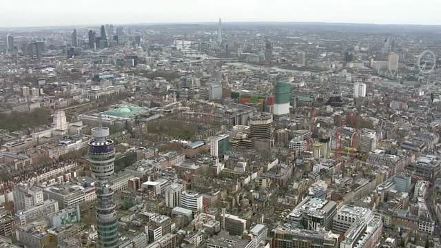 vídeos de stock e filmes b-roll de bt tower restaurant to reopen for golden anniversary air view / aerial bt tower and west end of london - bt tower londres