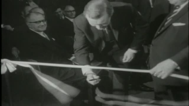 vídeos de stock, filmes e b-roll de bt tower restaurant to reopen to mark 50th anniversary fs190566007 / int tony benn mp and sir billy butlin cutting ribbons to open the top of the... - cortando fita